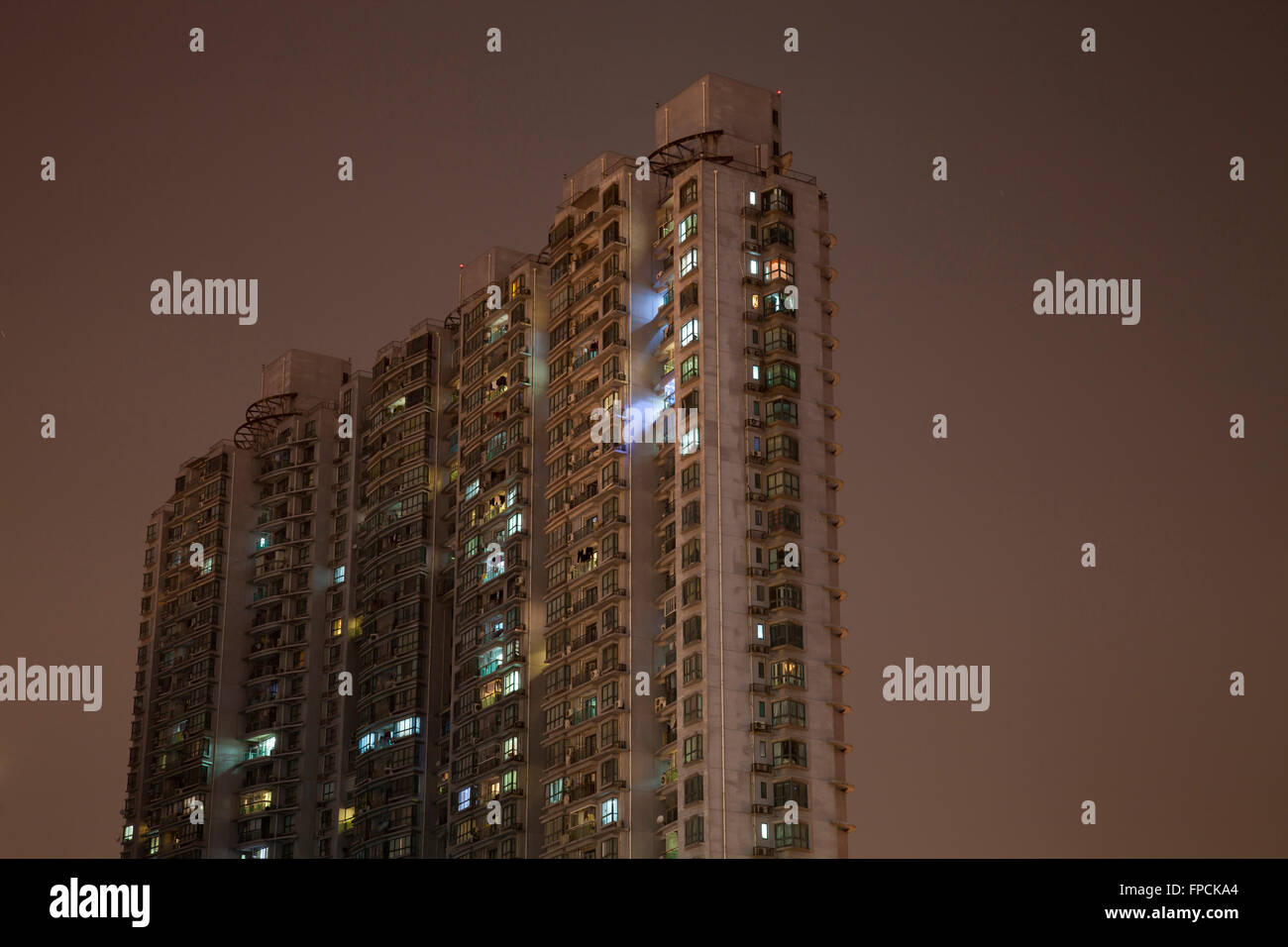 A view from below of apartment blocks in Shanghai, the building is called Moganshan Lu. - Stock Image