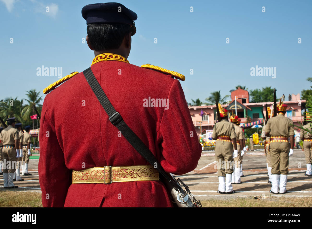 Rear view of a musician participating at the Independence Day parade. The musician belongs to a brass band ( India) - Stock Image