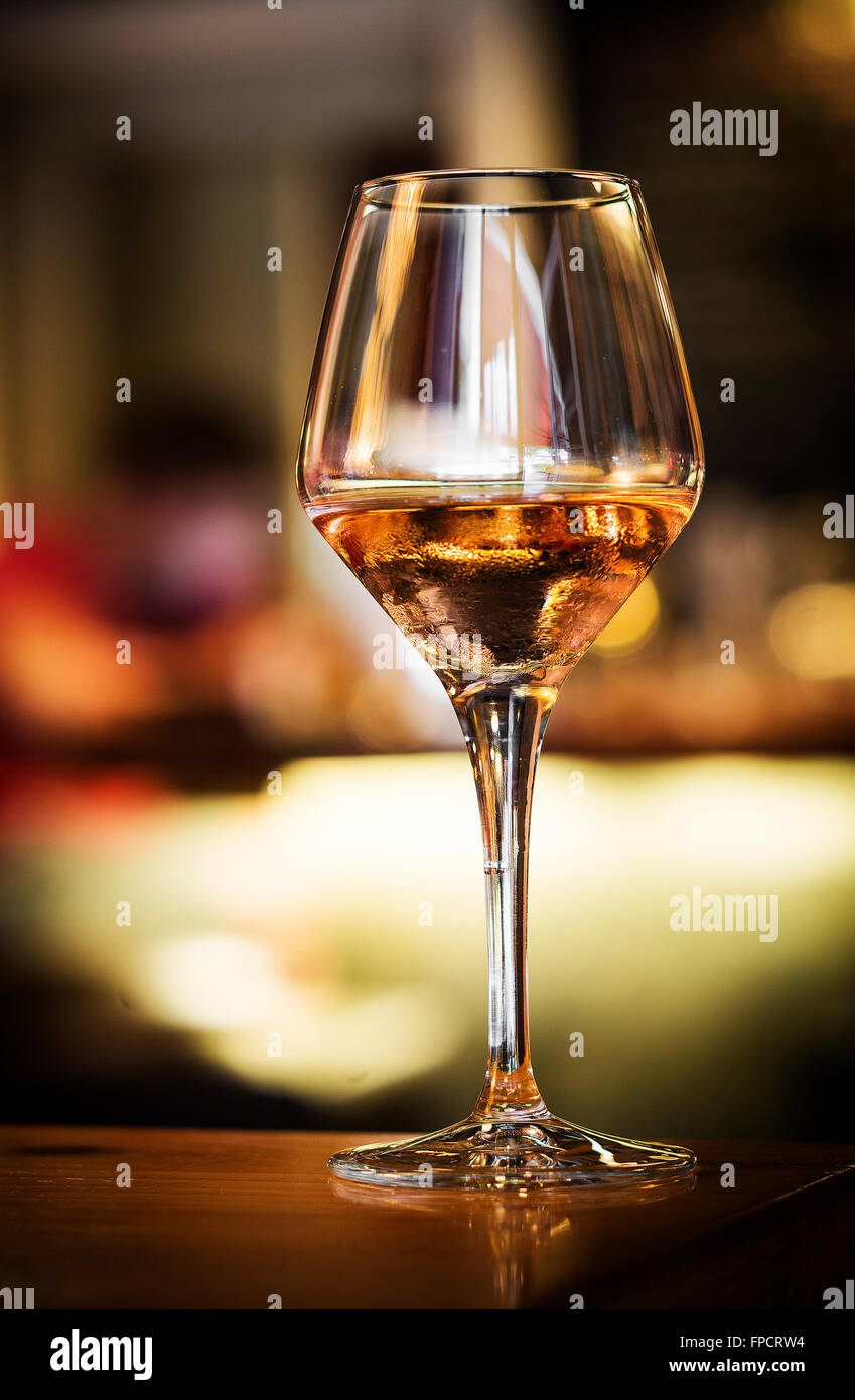 glass of spanish sherry wine on bar counter at night - Stock Image
