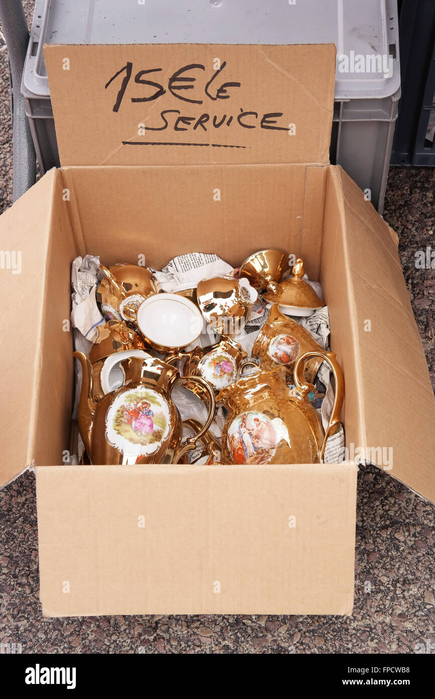 Cardboard box with Porcelain at a flea market in Brittany, France - Stock Image