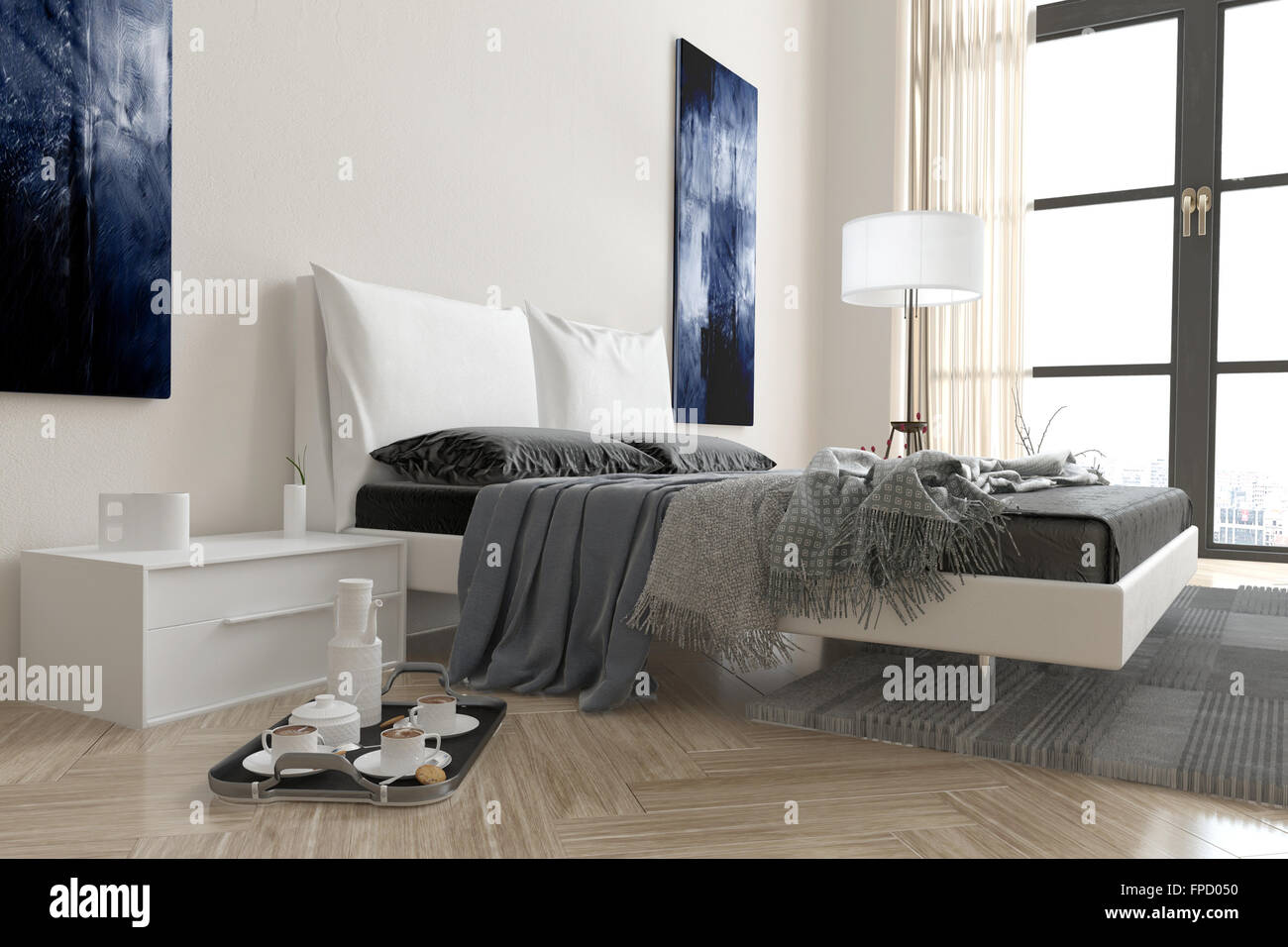 Modern bedroom interior with double divan bed covered in rugs and ...