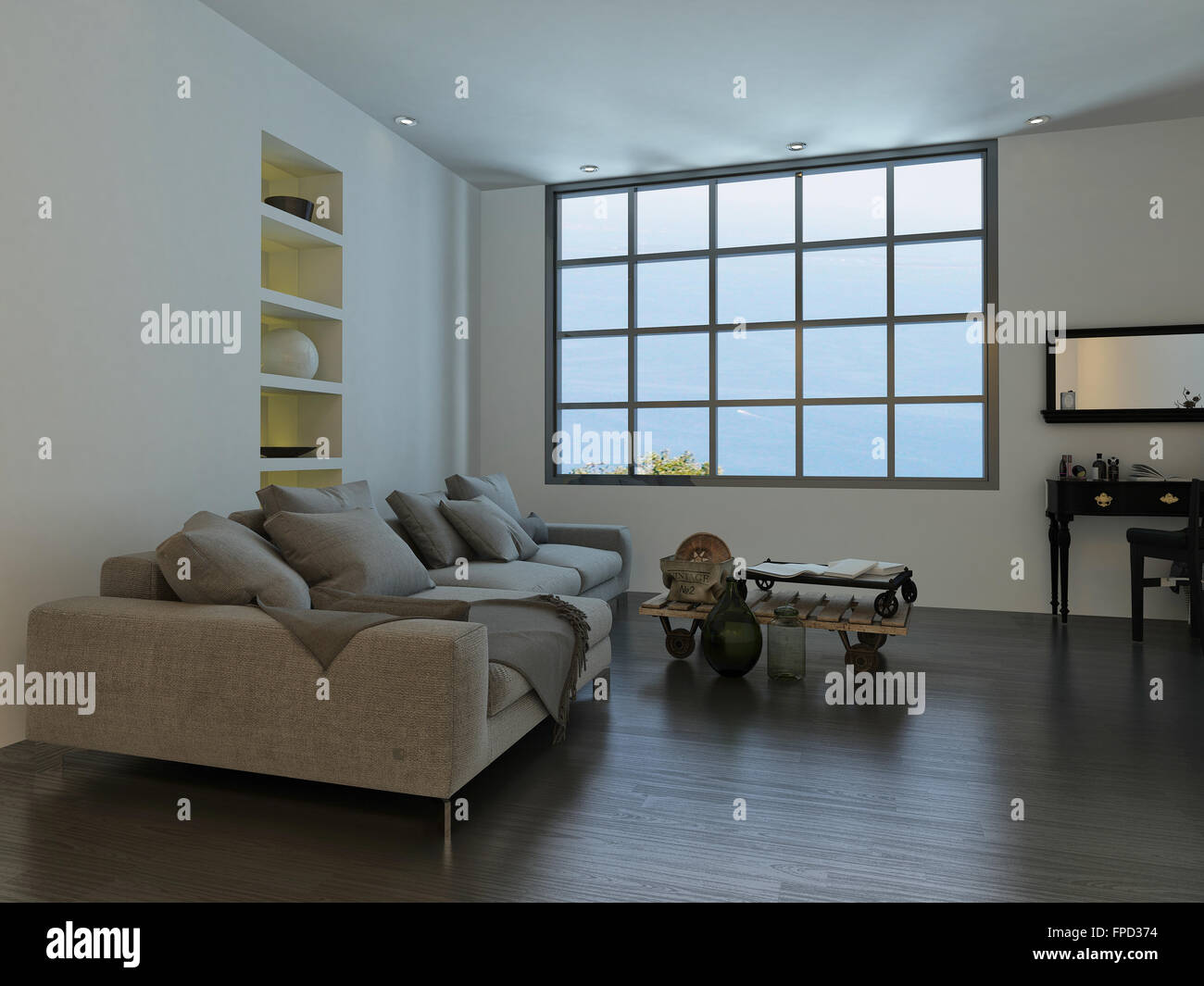 Living room with a large cottage-pane style window and a large white sofa with decorative ornaments, recessed shelves - Stock Image