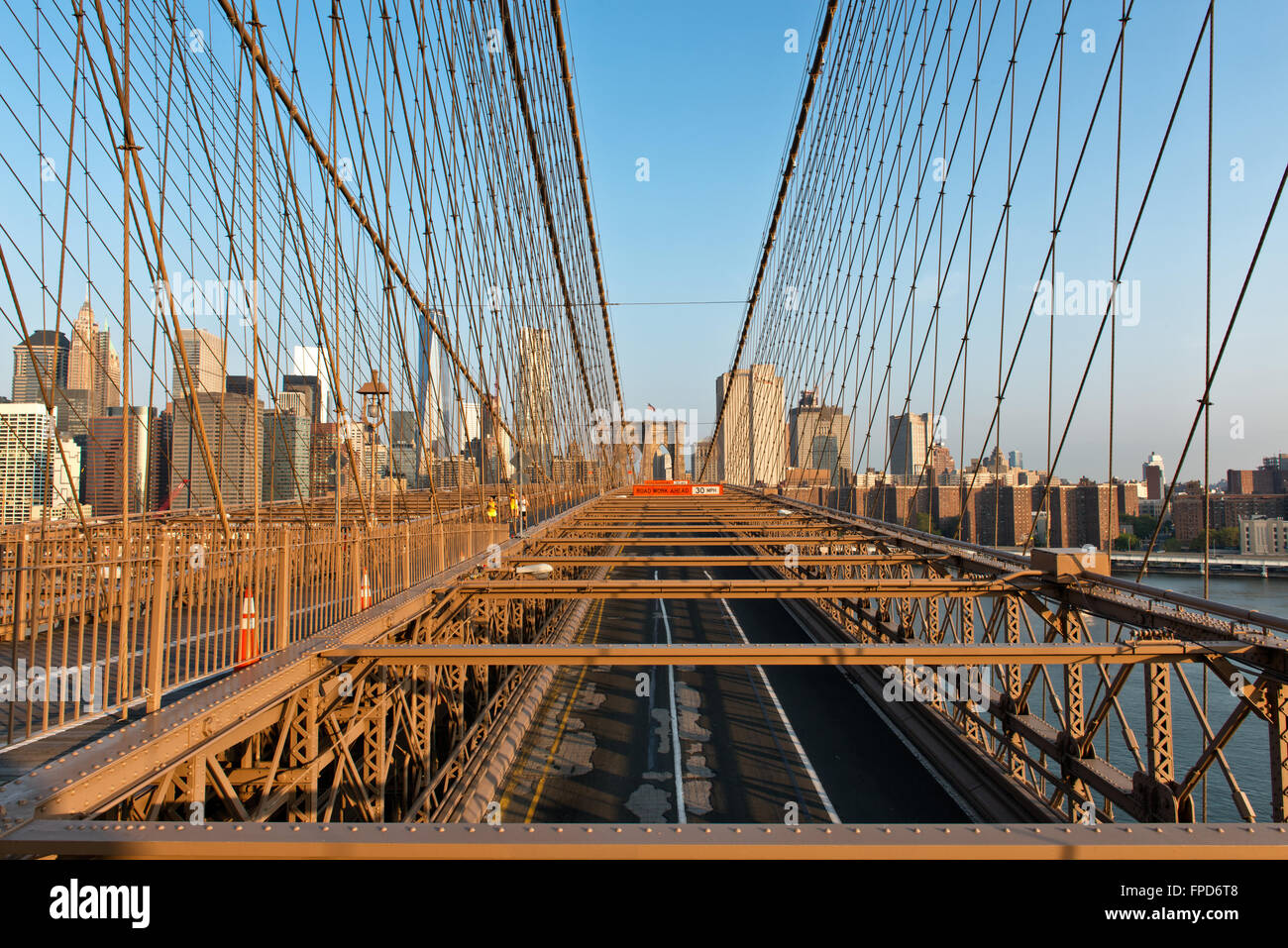 No Traffic on Brooklyn Bridge with Detail of Girders and Support Cables Looking Toward manhattan City Skyline at - Stock Image
