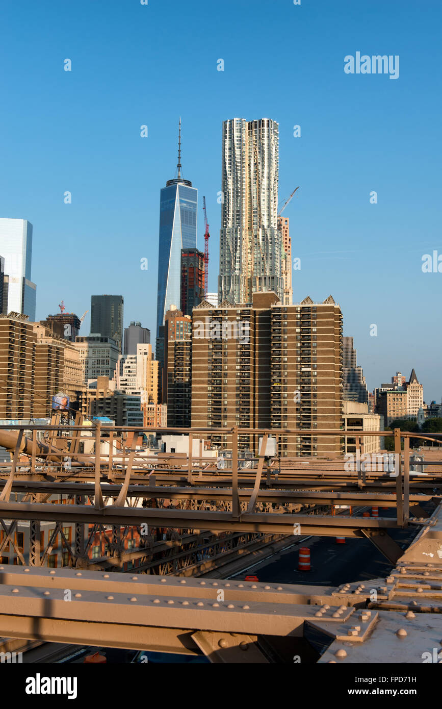 New York City Skyline with Gleaming One World Trade Center Building in Background on Sunny Day with Clear Blue Sky, - Stock Image