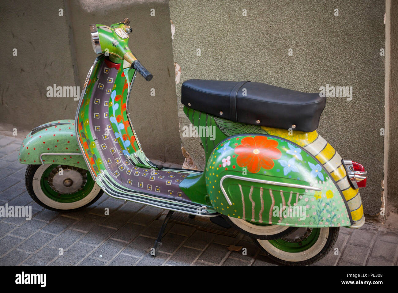 Motorcycle Vespa painted flowers in Palma de Mallorca,Balearic Islands,Spain. - Stock Image