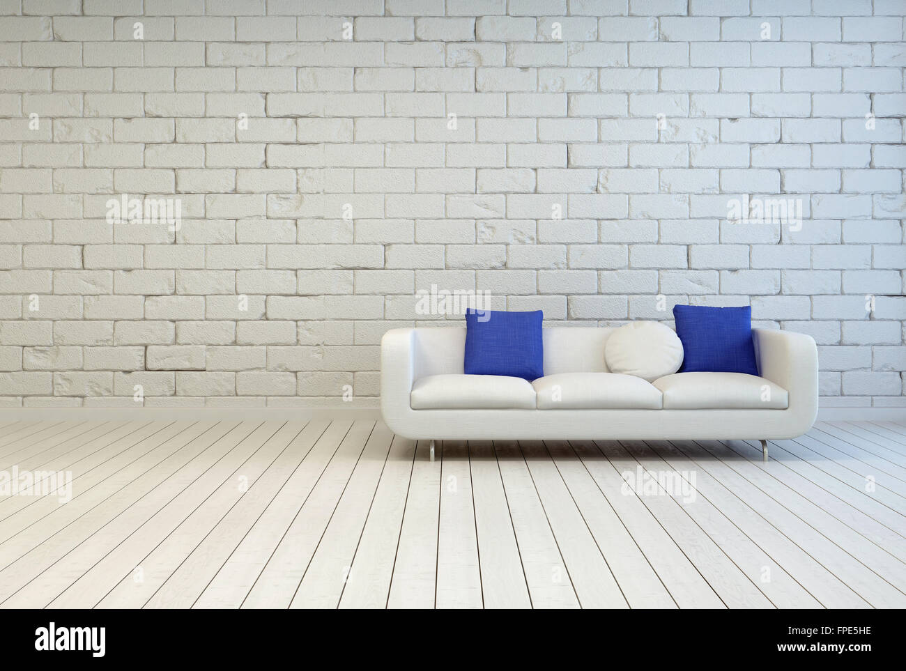 Elegant White Couch With White and Blue Pillows on an Empty Living ...