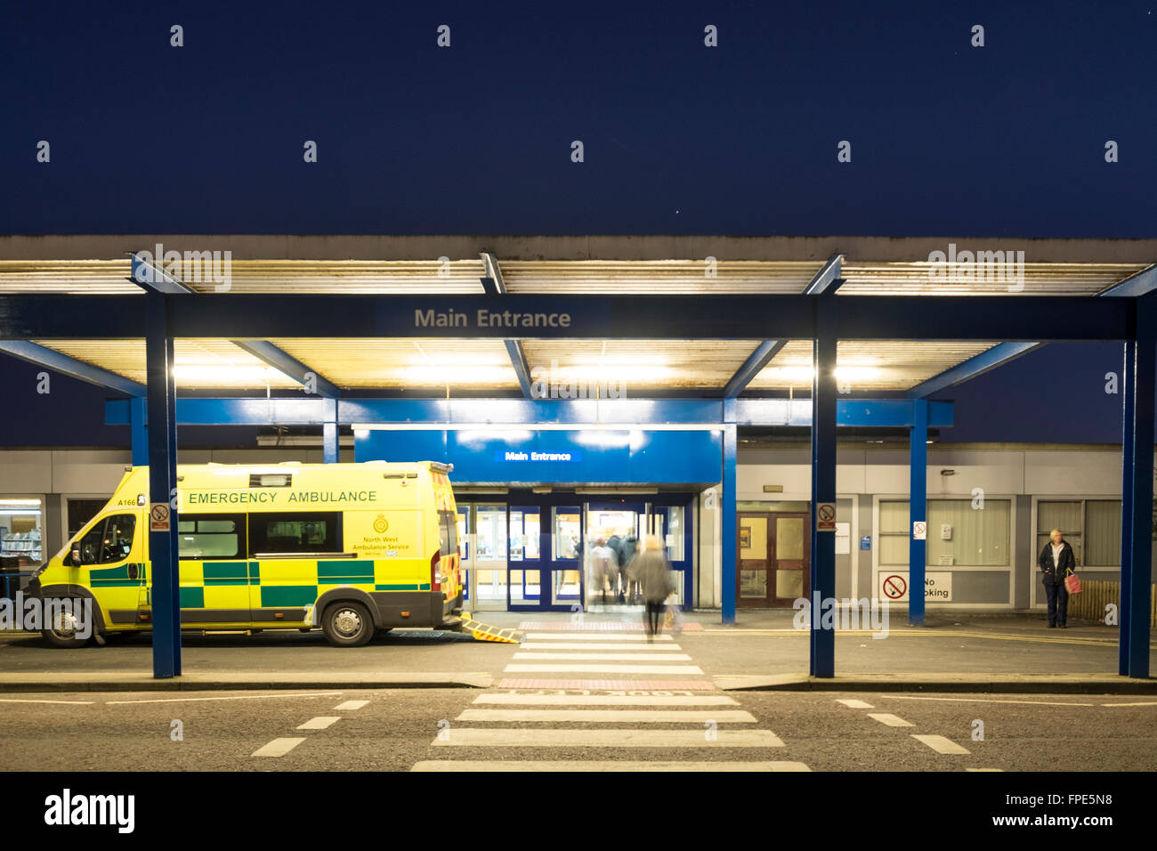 Entrance to the Royal Preston Hospital at night with ambulance parked outside - Stock Image