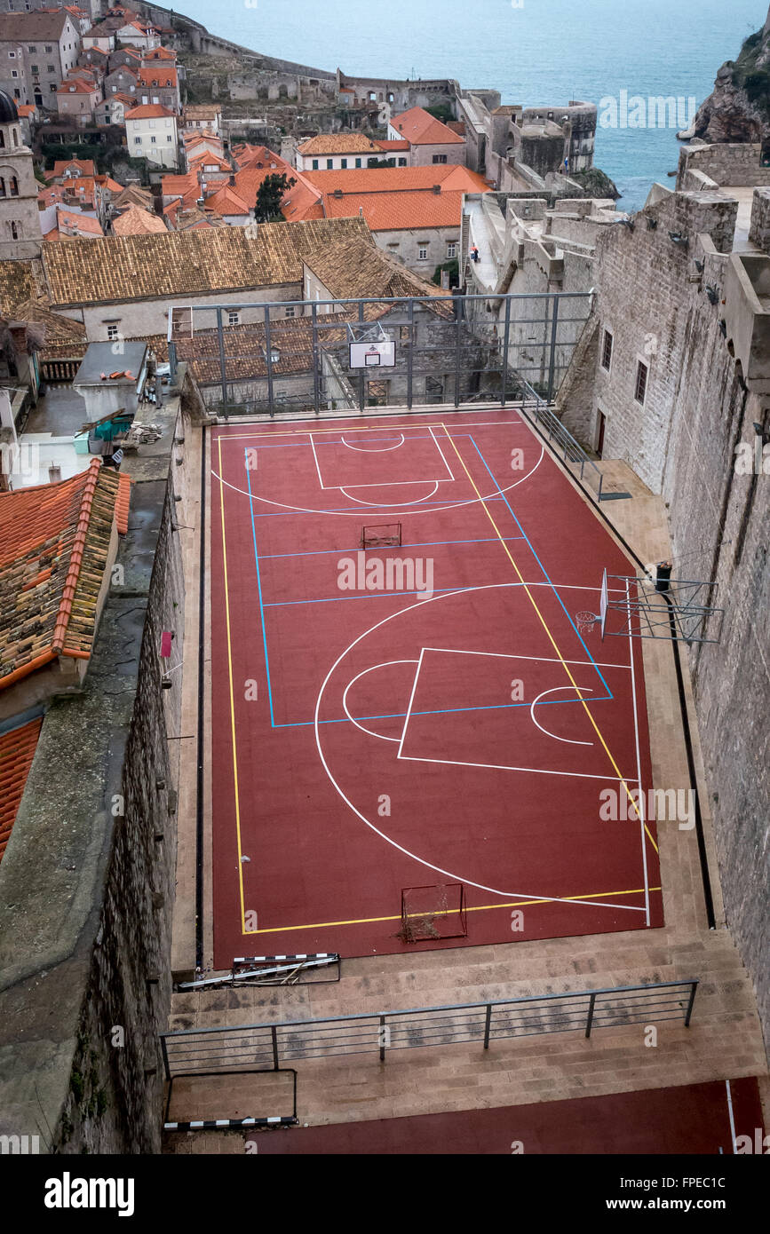 Unusual basketball court in a cramped space in the old city of Dubrovnik, Croatia. - Stock Image