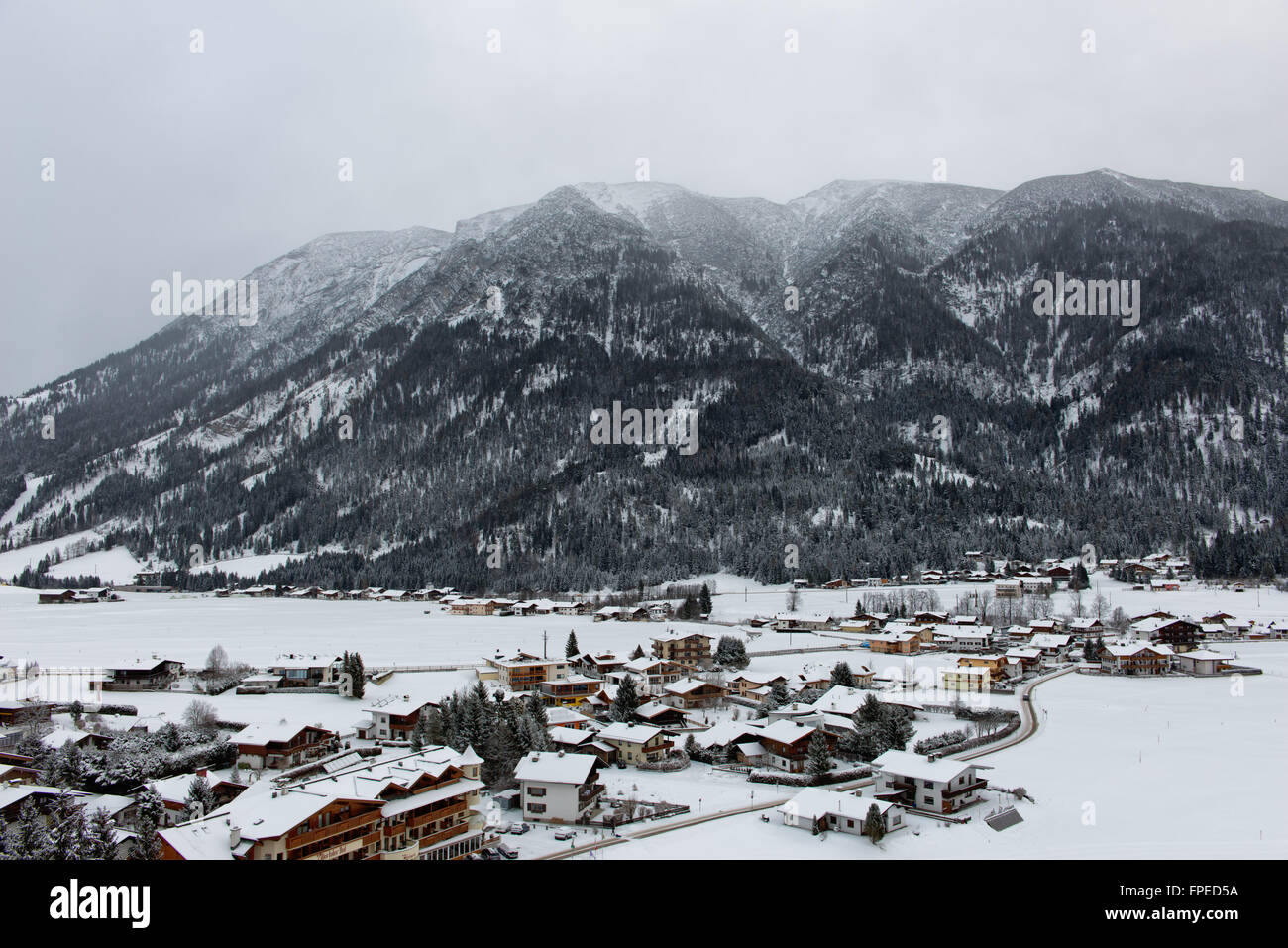 High angle view of Achenkirch, Austria, a scenic ski resort in an alpine valley under a thick covering of white - Stock Image