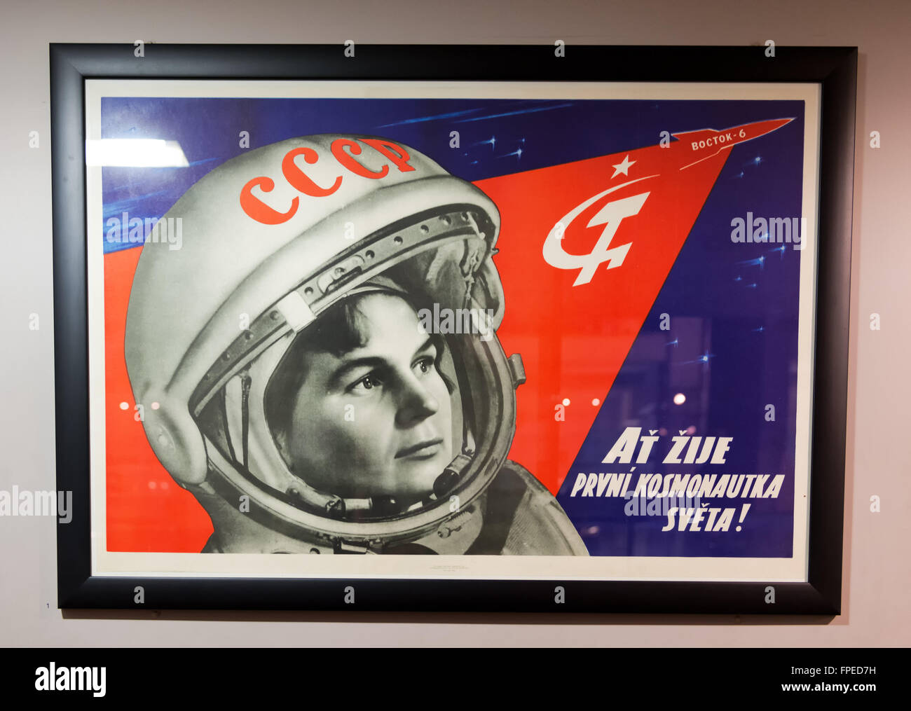 Close up of original vintage Soviet cosmonaut poster behind glass frame on display in a museum - Stock Image