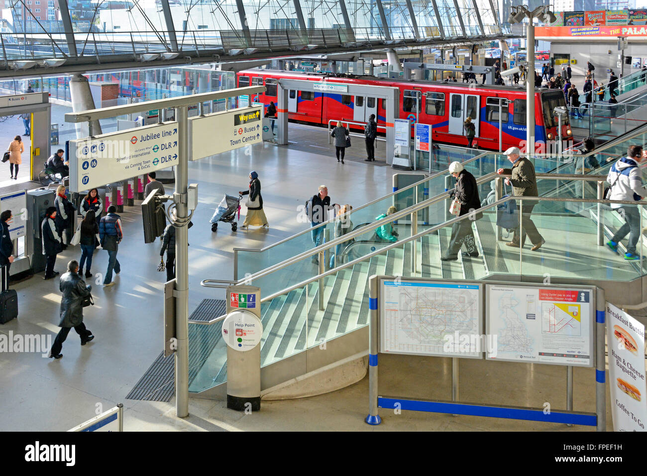 Interior Stratford London UK train station interchange concourse for Docklands Light Railway service at platform - Stock Image