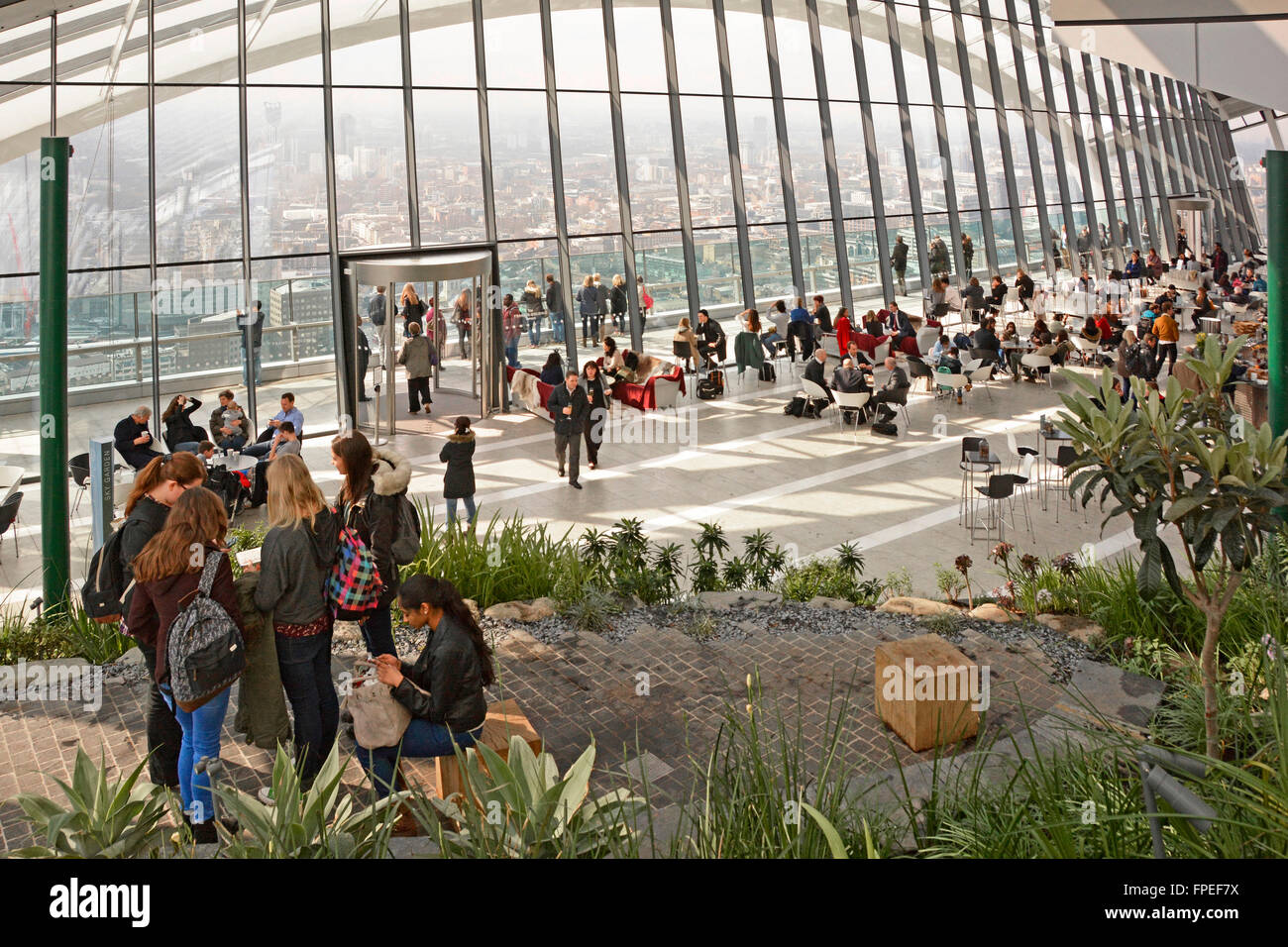 Visitors & tourists a  public Sky Garden at top of landmark Walkie Talkie skyscraper office building at 20 Fenchurch - Stock Image