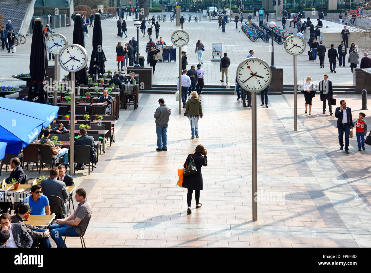 Five of six public clocks installation by Konstantin Grcic on Reuters Plaza at Canary Wharf London Docklands Tower - Stock Image