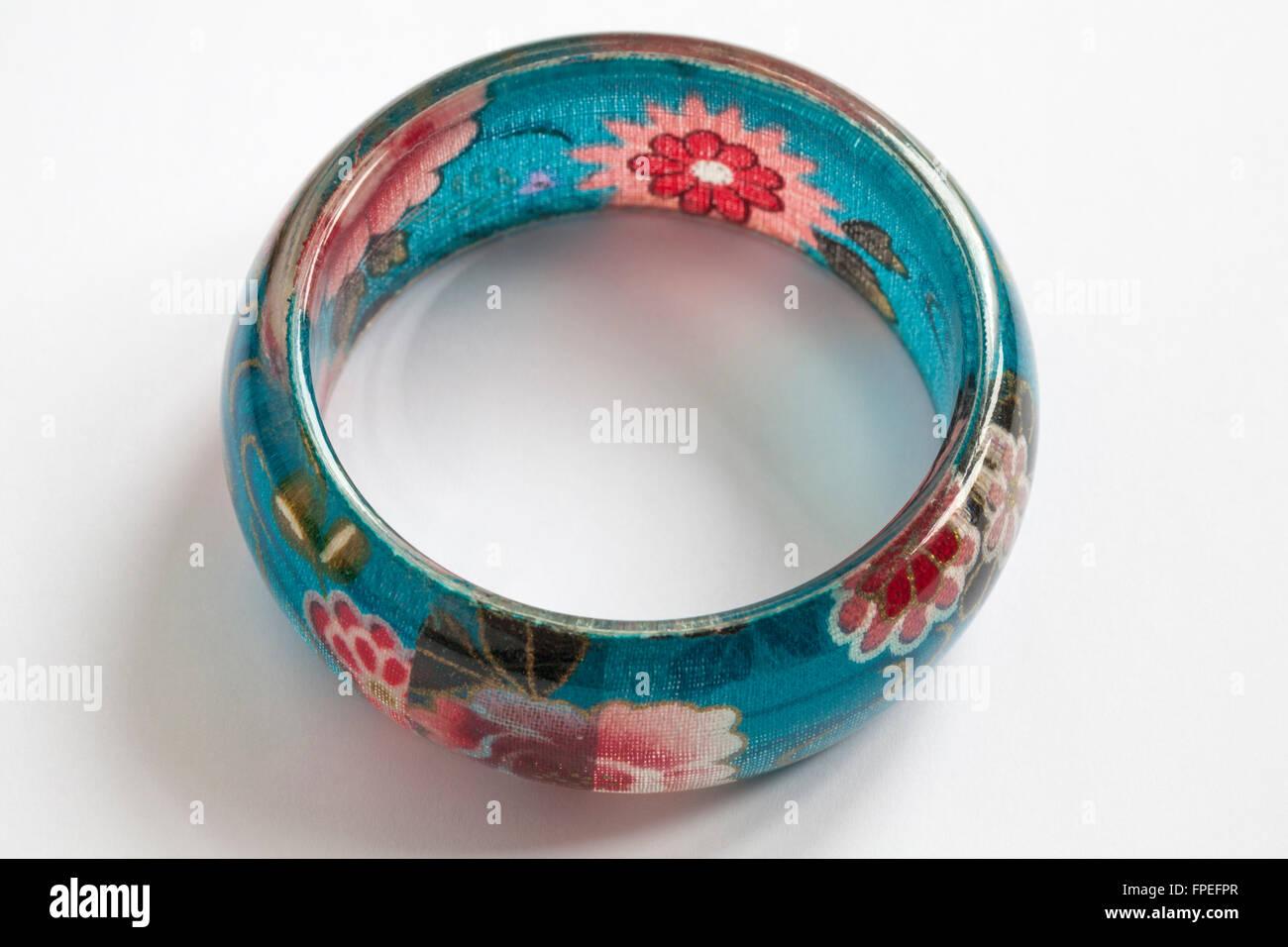Blue flowery bangle isolated on white background - Stock Image