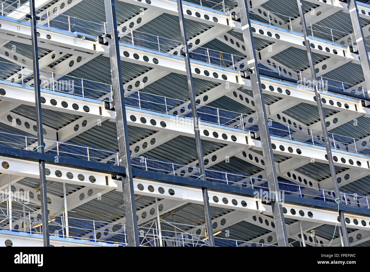 Steel frame multi storey office development showing steel decking & factory made round apertures for routing services Stock Photo