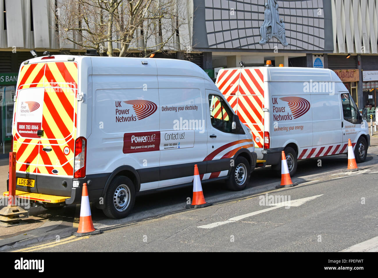 Two UK Power Networks vans parked up during street works to underground electricity supplies in East Croydon South - Stock Image