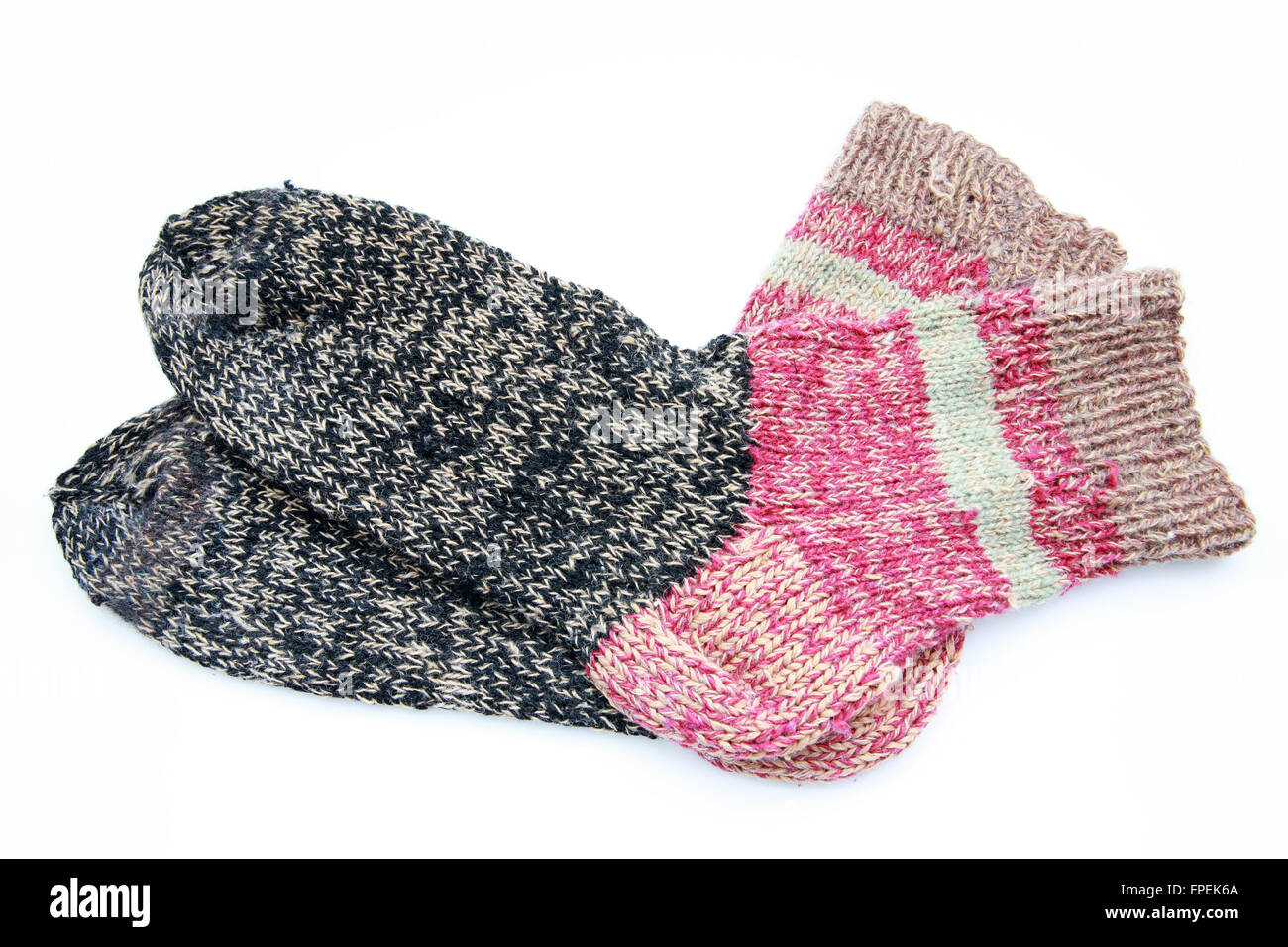 Knitted wool socks on a white background - Stock Image