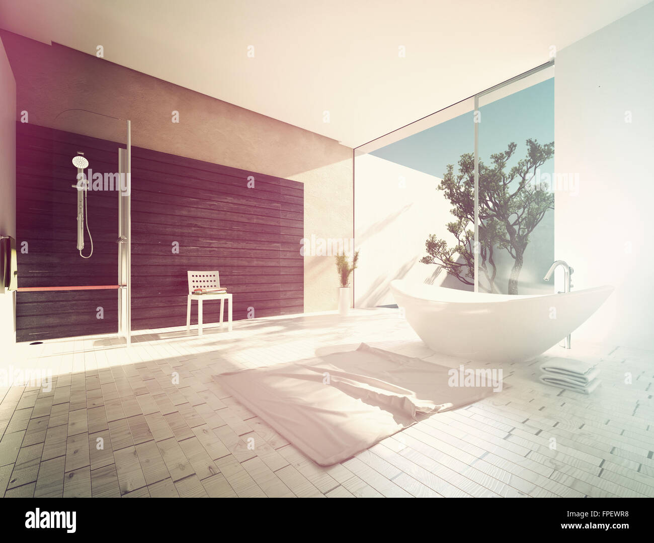 Boat-shaped freestanding tub in a spacious sunny modern bathroom with parquet floors, grey accent wall and shower Stock Photo