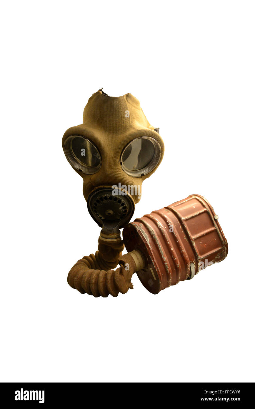 Old vintage gas mask and canister issued as protective gear during the war against biohazards and toxic gas, isolated - Stock Image