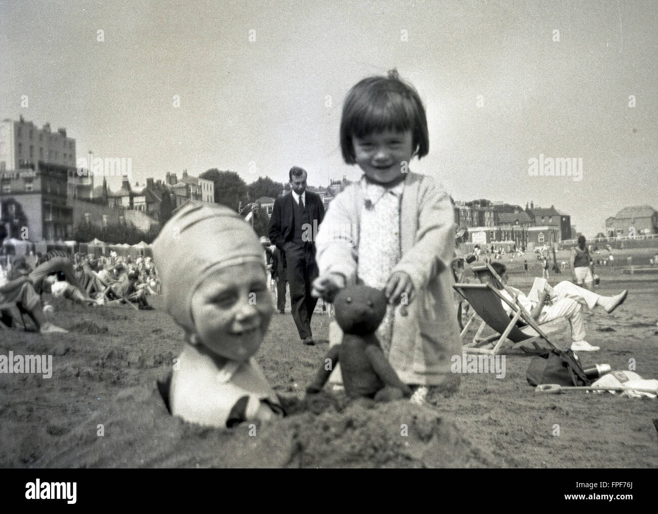 1930s historical, picture of two young girls enjoying themselves on a beach. - Stock Image