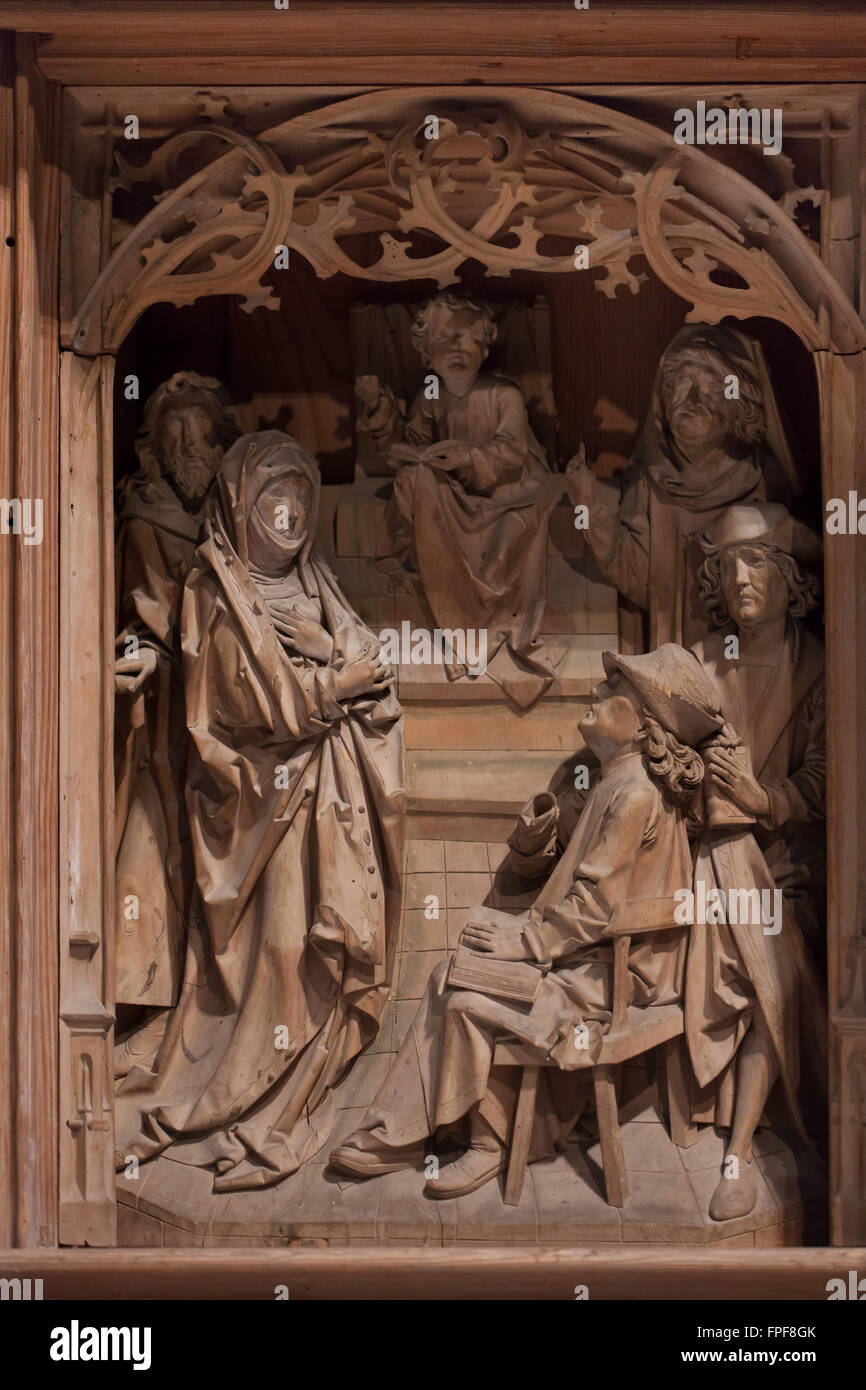 Twelve-year-old Jesus among the Doctors at the Temple. Predella panel of the Virgin Mary Altarpiece by German sculptor - Stock Image