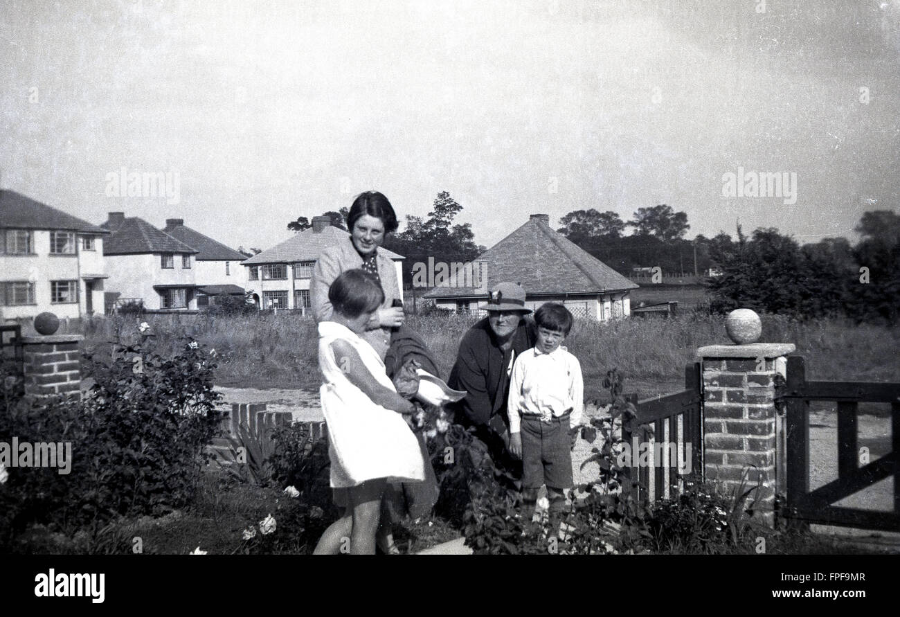 1930s historical, mother, grandmother and children at entrance to house, England. Stock Photo
