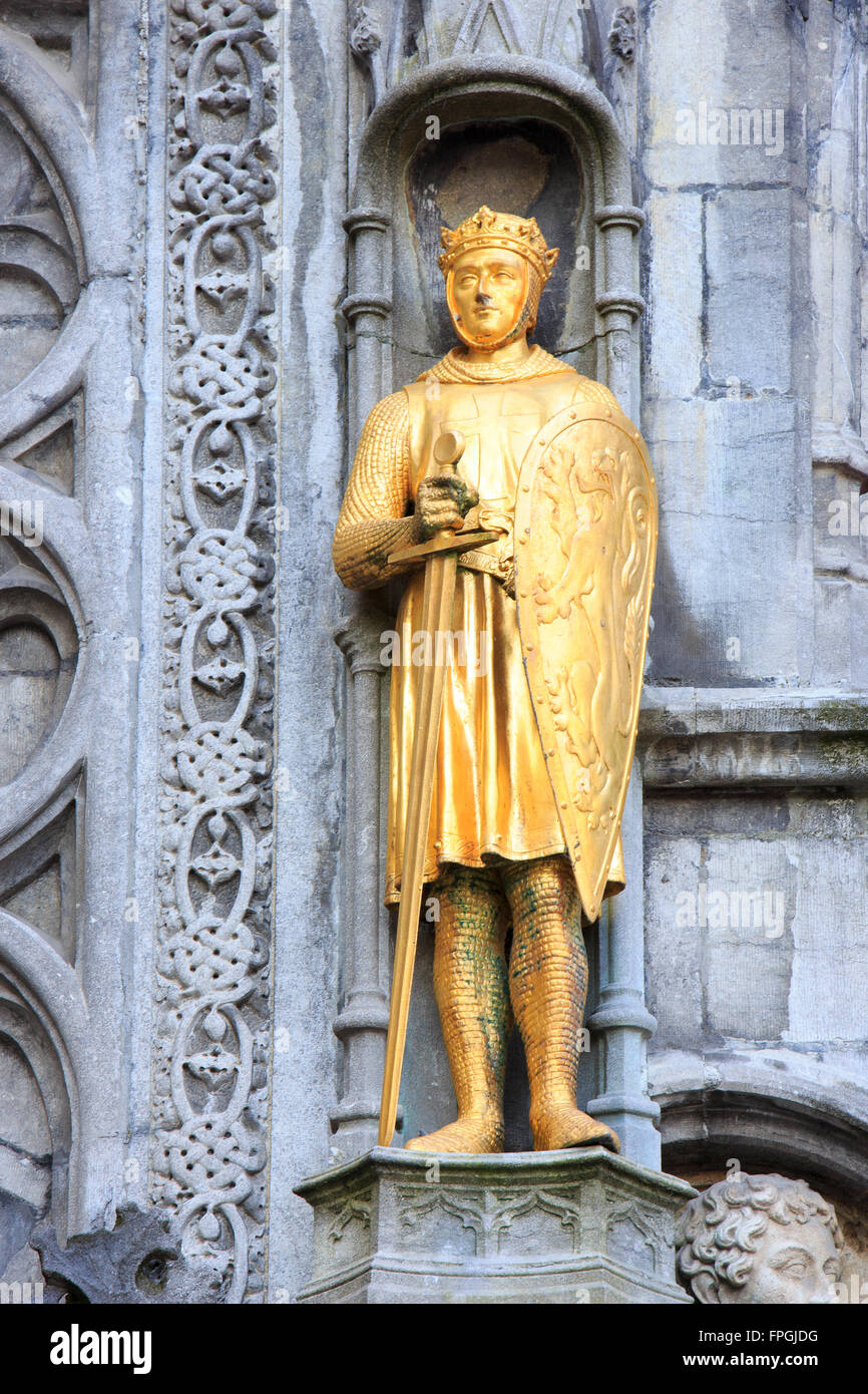 Golden statue of a knight on the facade of the Basilica of the Holy Blood in Bruges, Belgium Stock Photo