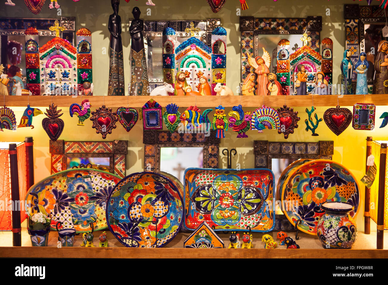 Mexican and Guatemalan pottery and tin work at Cinnabar, Cambria, California - Stock Image