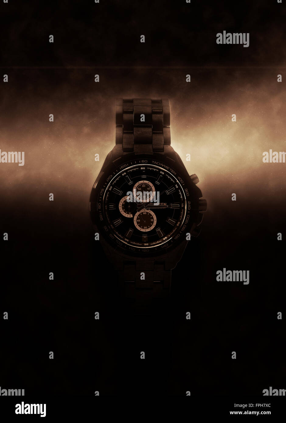 Luxury Design Black Wristwatch Chronograph Lit Dramatically from Side on Dark Background with Glowing Effect - Stock Image