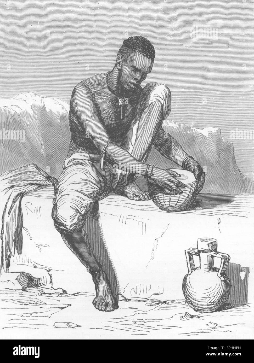 SUDAN: Dinka Tribesman, White Nile, mending his drum, antique print 1880 - Stock Image