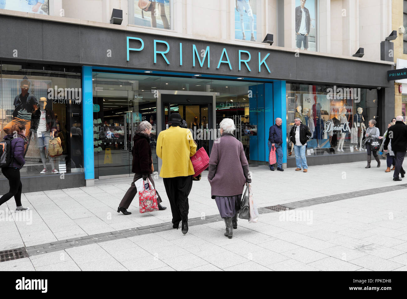 Shoppers outside the entrance of a Primark store on Queen Street in Cardiff City Centre Wales UK  KATHY DEWITT - Stock Image