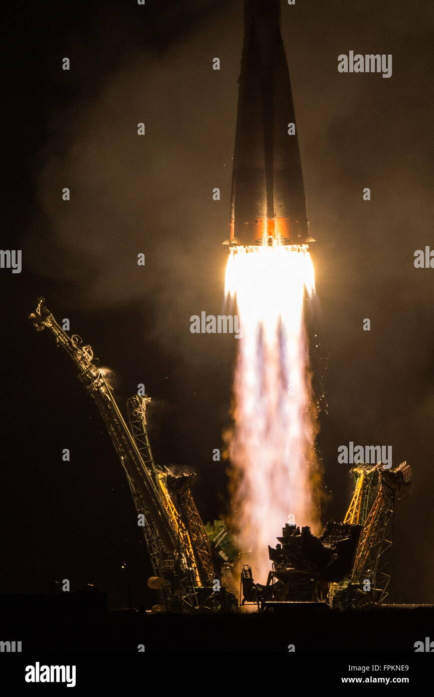 Baikonur, Kazakhstan. 19th Mar, 2016. A Soyuz FG rocket with the Soyuz TMA-20M spacecraft carrying the ISS Expedition Stock Photo