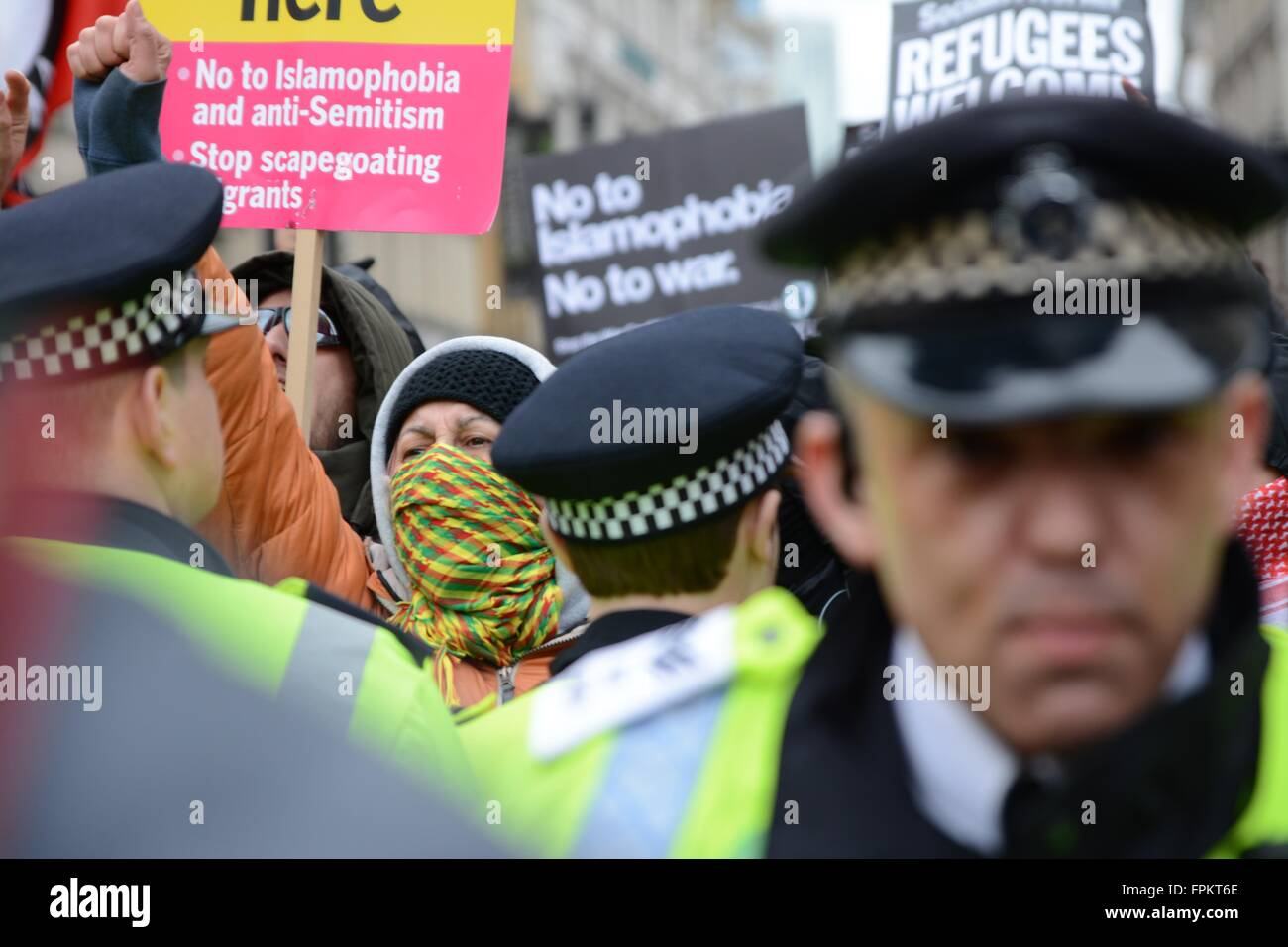 London, UK. March 19th 2016. Masked protester shouts towards another group who identify themselves as Britain First. - Stock Image