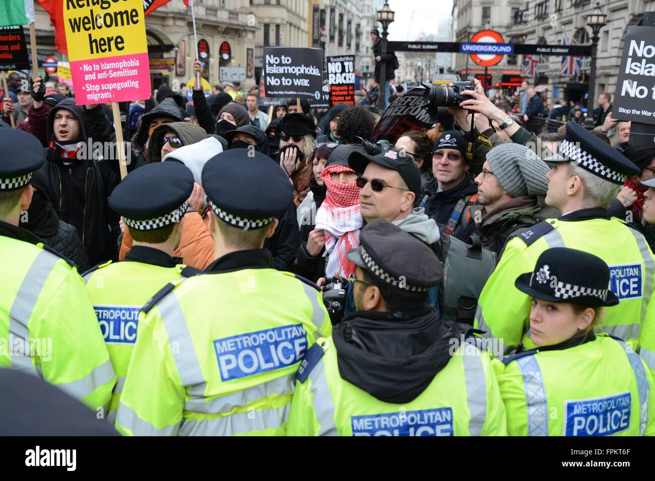 London, UK. March 19th 2016. Police holding the cordon between anti-Fascists and Britain First. Credit:  Marc Ward/Alamy - Stock Image