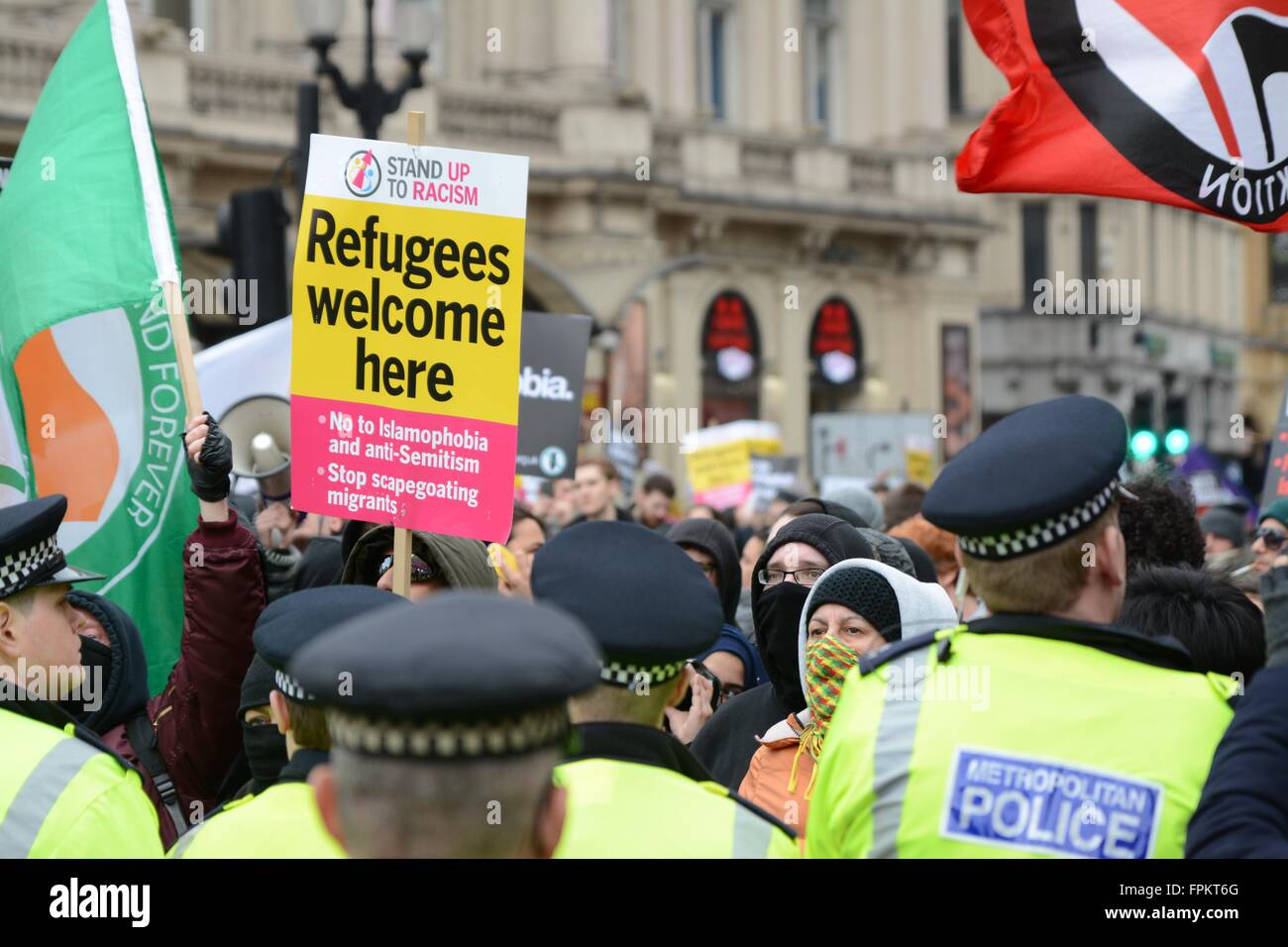 London, UK. March 19th 2016. Placard is held aloft as anti-Fascists and Britain First faces off. Credit:  Marc Ward/Alamy - Stock Image