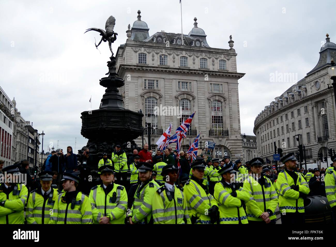 London, UK. March 19th 2016. Police hodlding their lines between Britain First and anti-Fascist organisations in - Stock Image