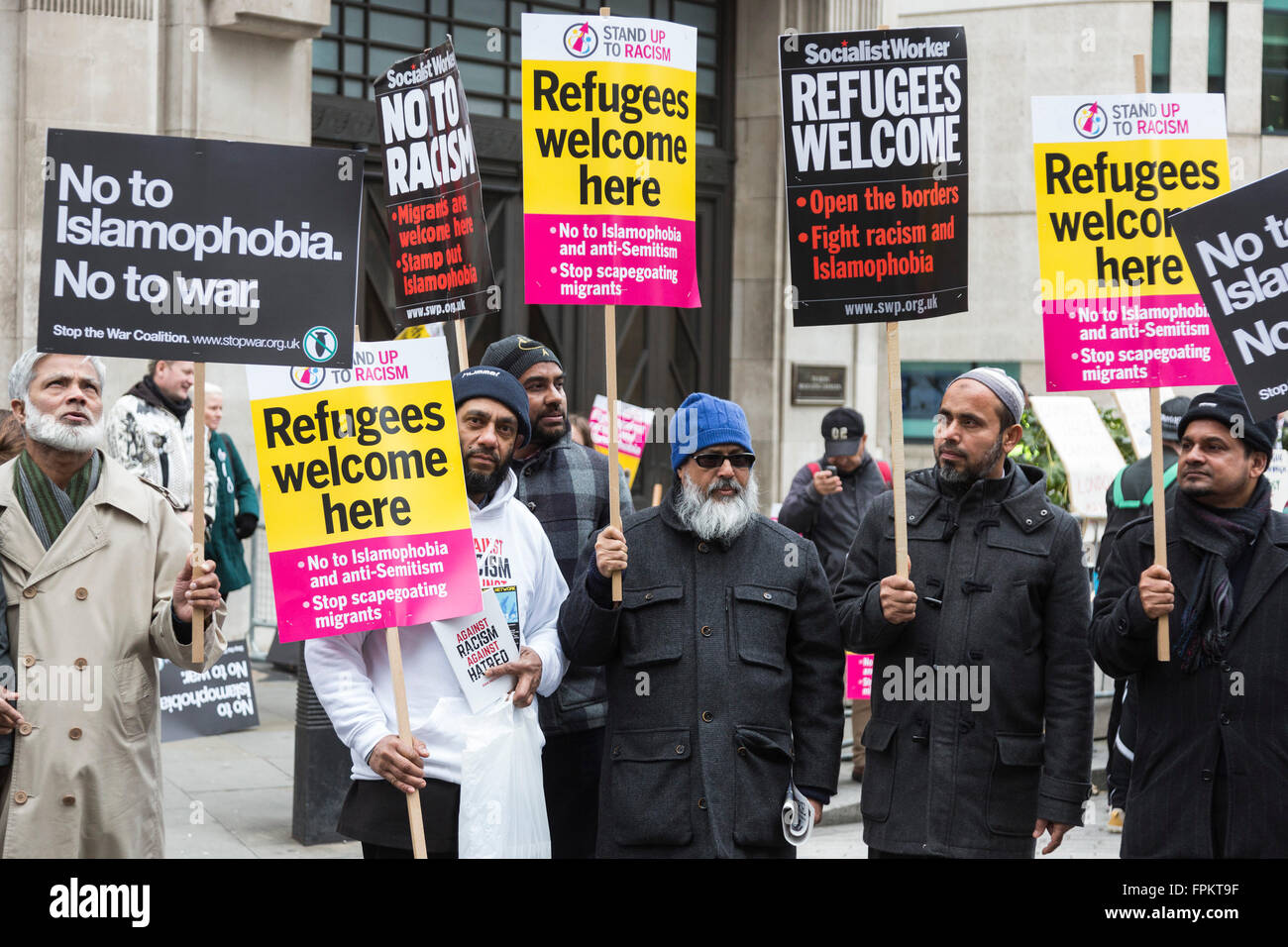 London, UK. 19 March 2016. Muslim men holding up posters against Islamophobia and racism. Thousands of protesters - Stock Image