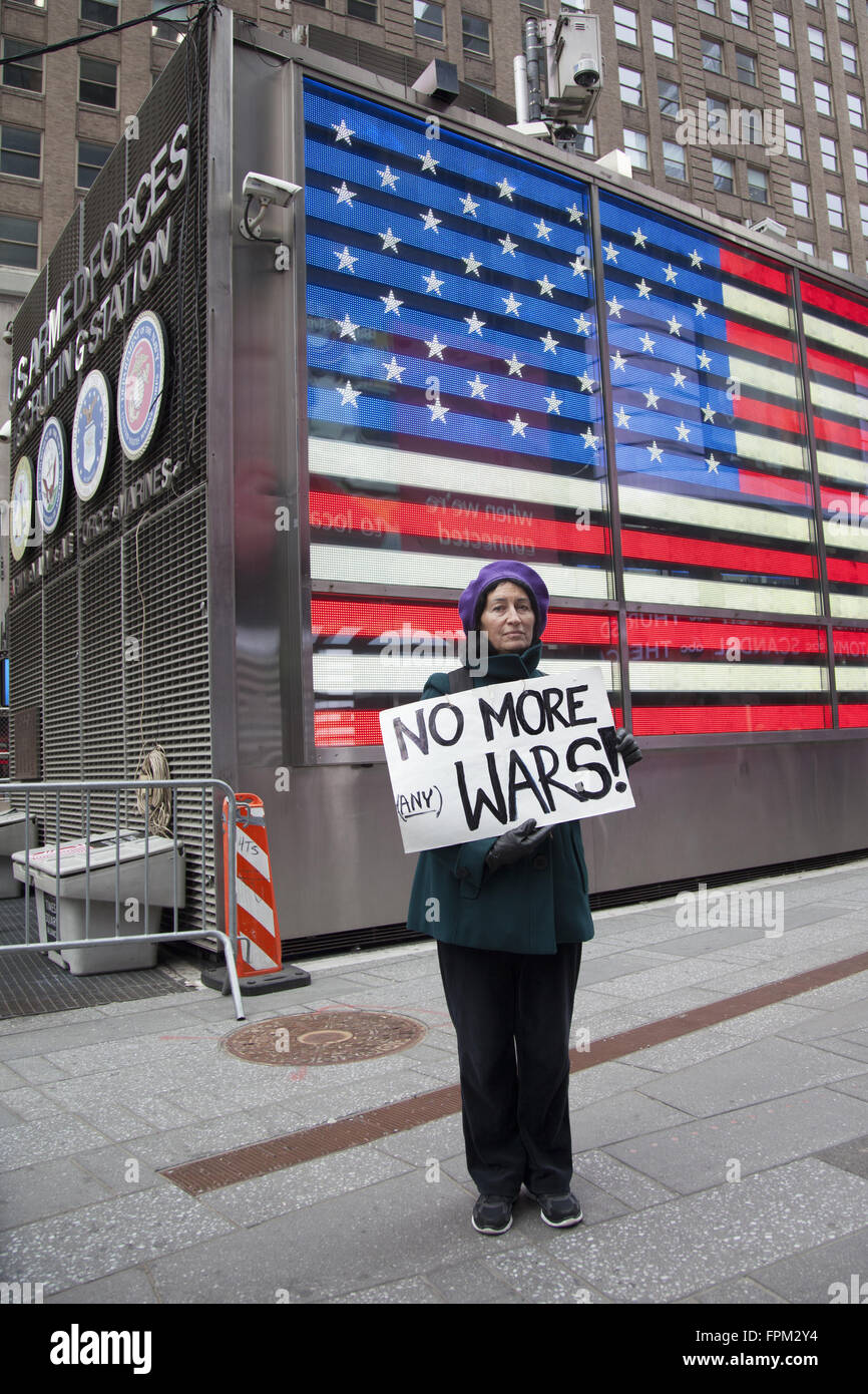 New York, USA. 19th Mar, 2016. Coalition of activist groups march and have a silent vigil bringing attention to Stock Photo