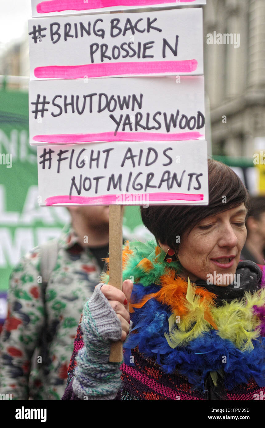 London, UK. Saturday 19th March 2016. A protester carries a homemade placard calling for the closure of immigration - Stock Image