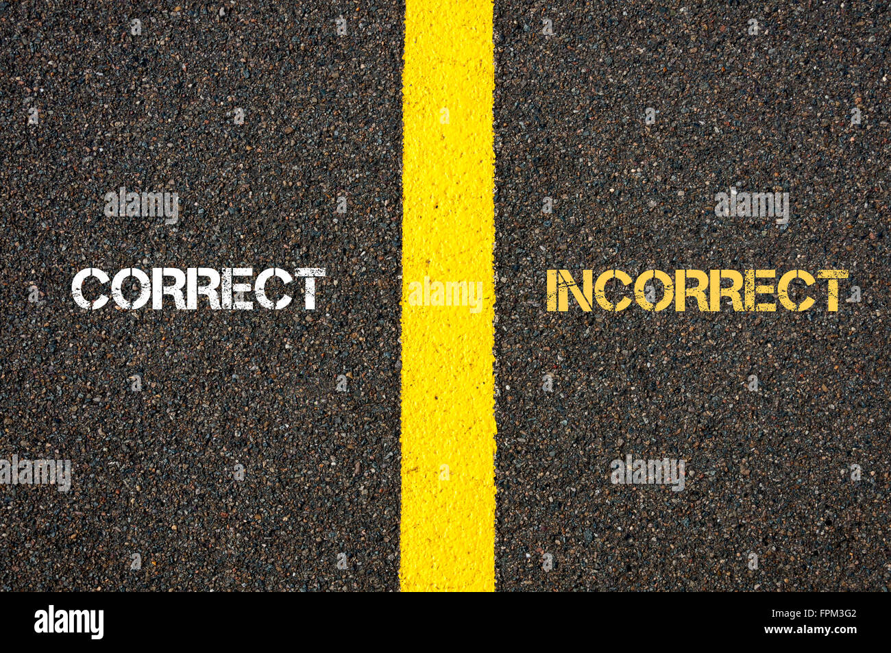 Antonym concept of CORRECT versus INCORRECT written over tarmac, road marking yellow paint separating line between - Stock Image