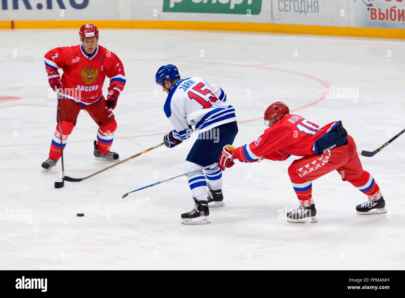 MOSCOW - JANUARY 29, 2016: P. Bure (10) vs L. Jarvi (15) on hockey game Finland vs Russia on League of World legends - Stock Image