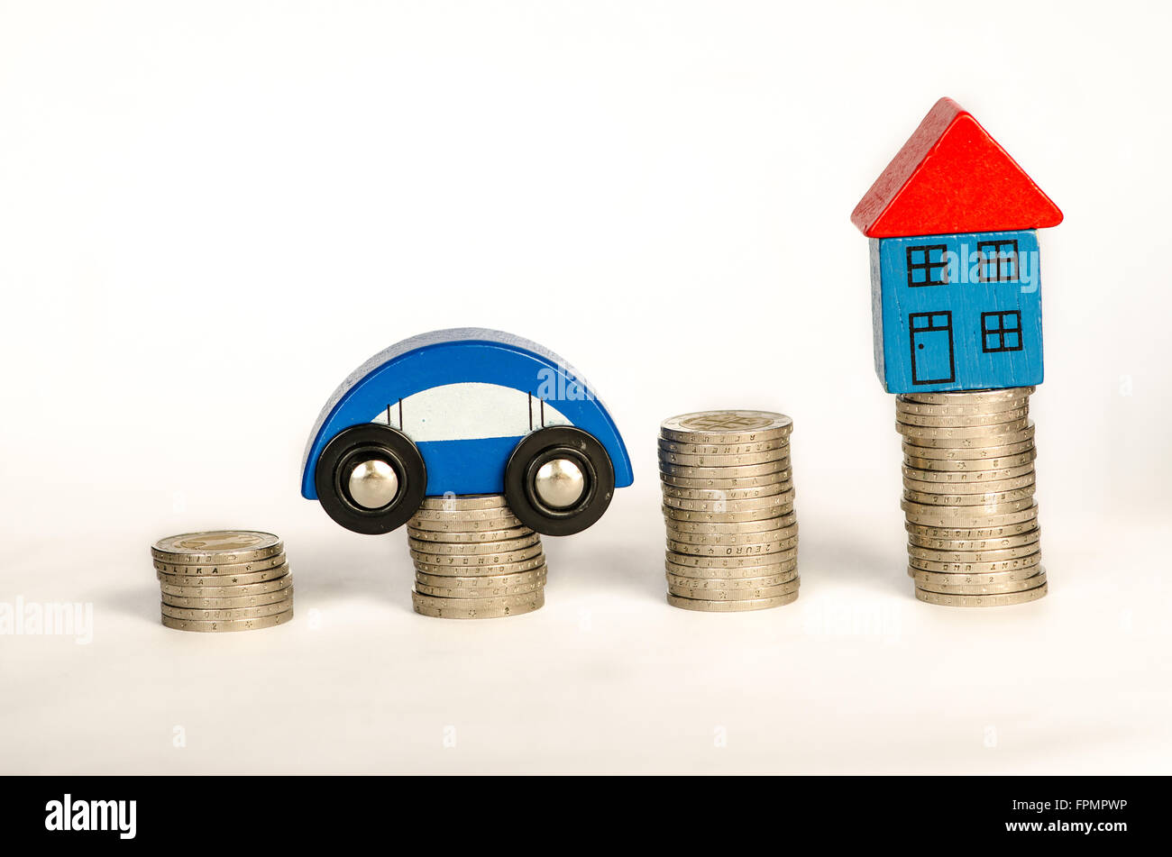 pile of coins, house and car detail image - Stock Image