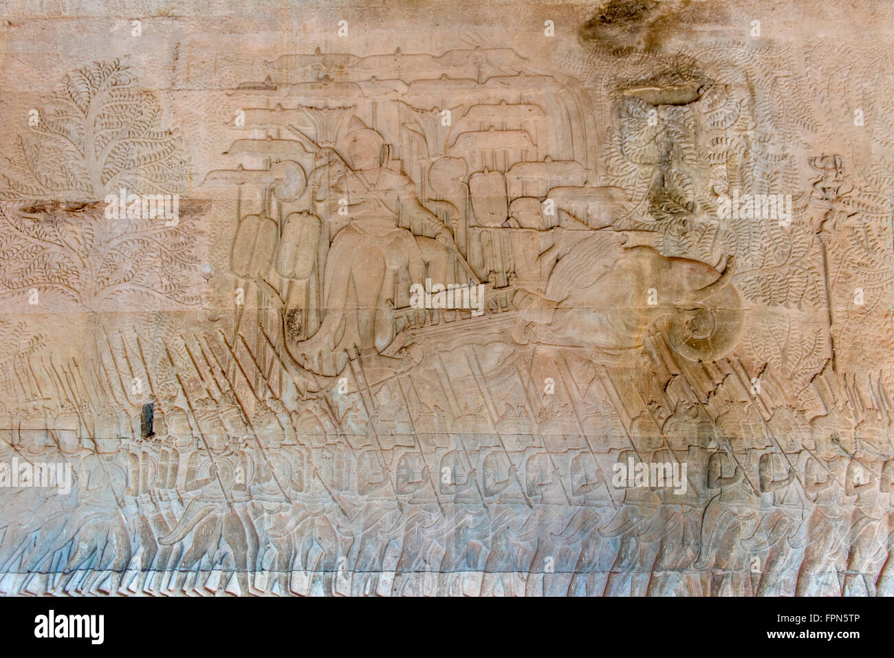Angkhor Wat, Cambodia  Bas relief showing an officer or the king on an elephant and shaded by parasols Stock Photo