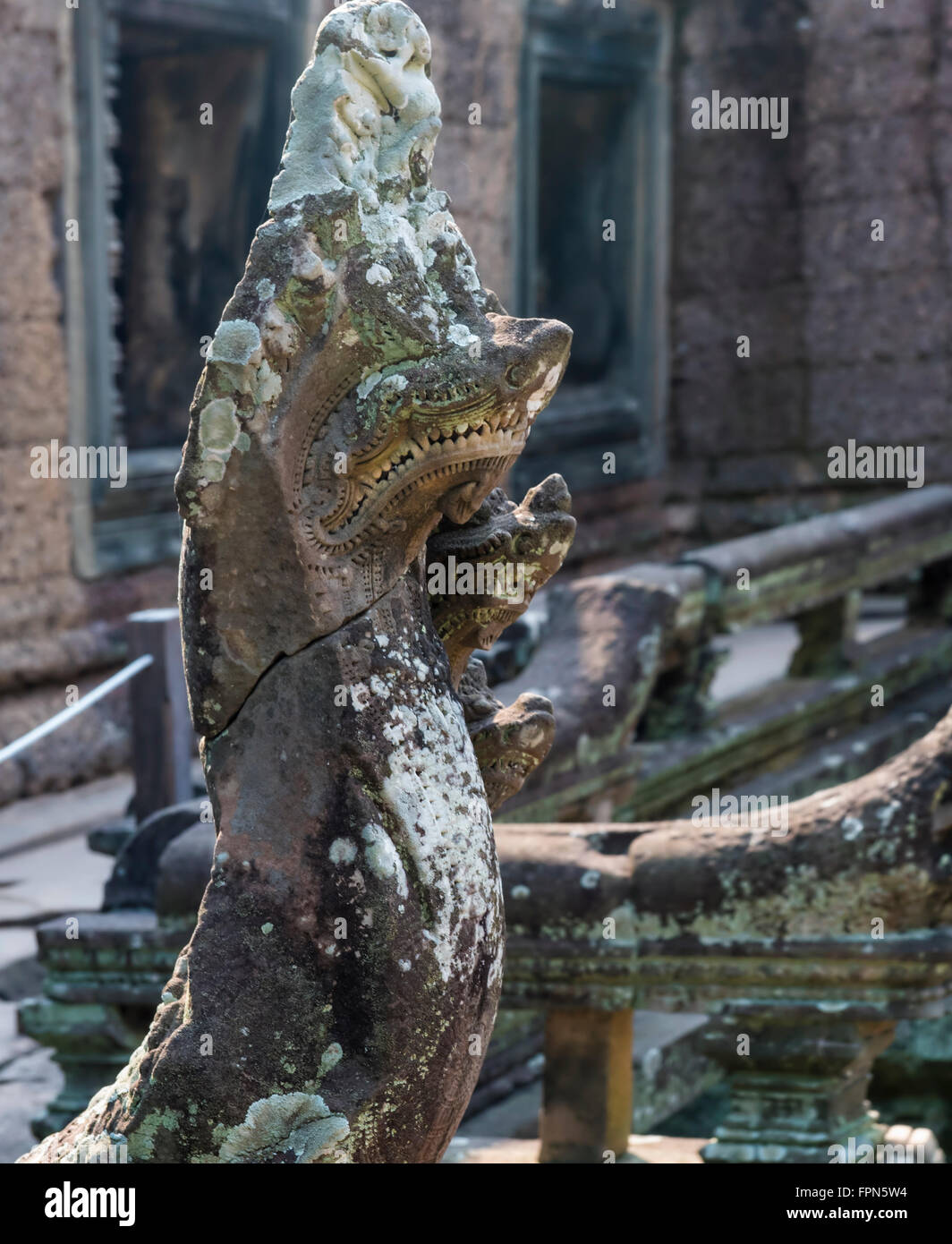 Statue of a Naga, or snake encrusted with lichens, with