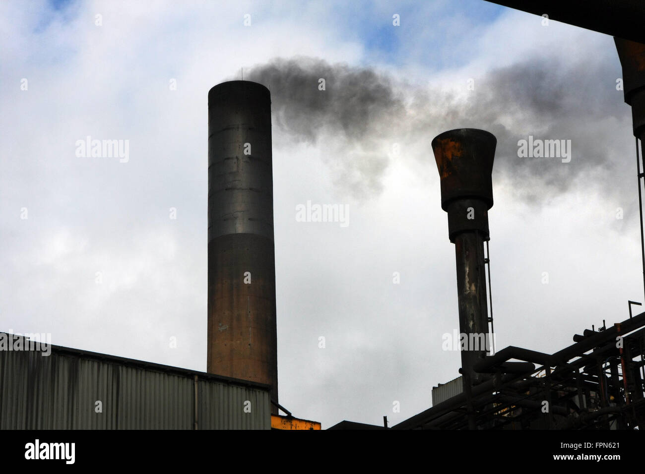 Smoke and emissions from factory chimneys. - Stock Image