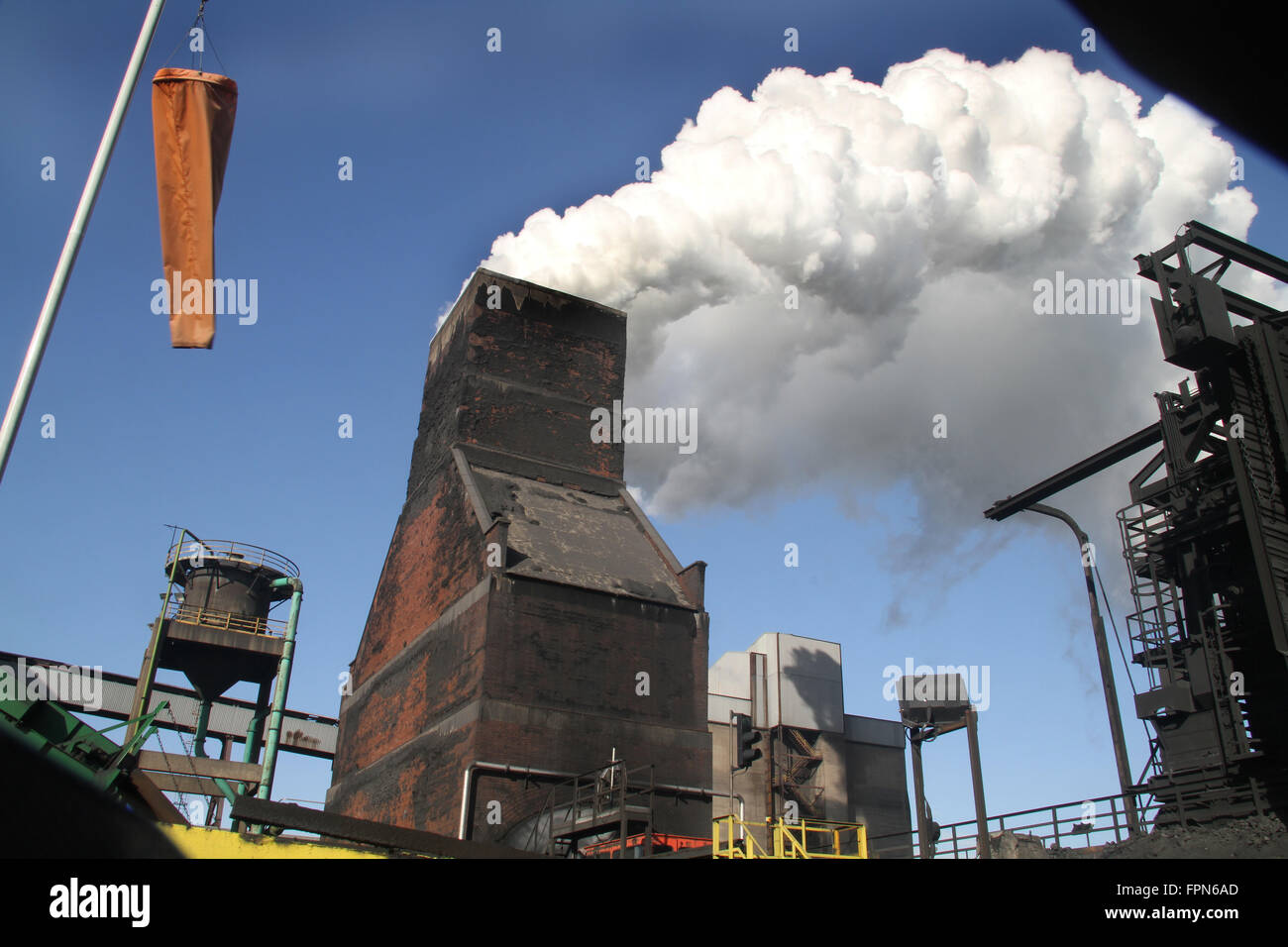 Steam from coke oven quenching tower. - Stock Image