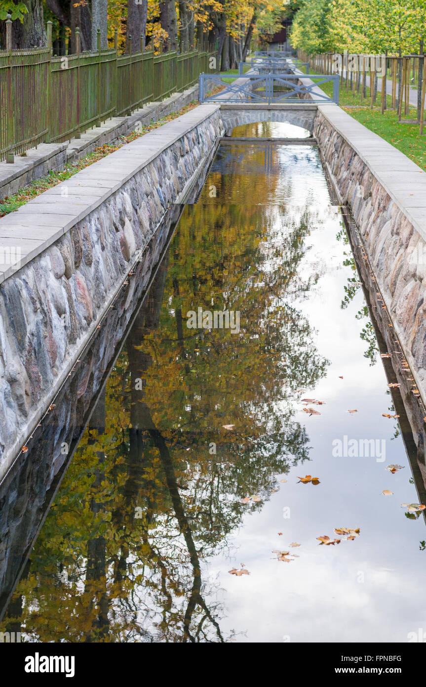 Canal closeup with autumn tree reflection in water, Kadriorg, Tallinn, Estonia - Stock Image