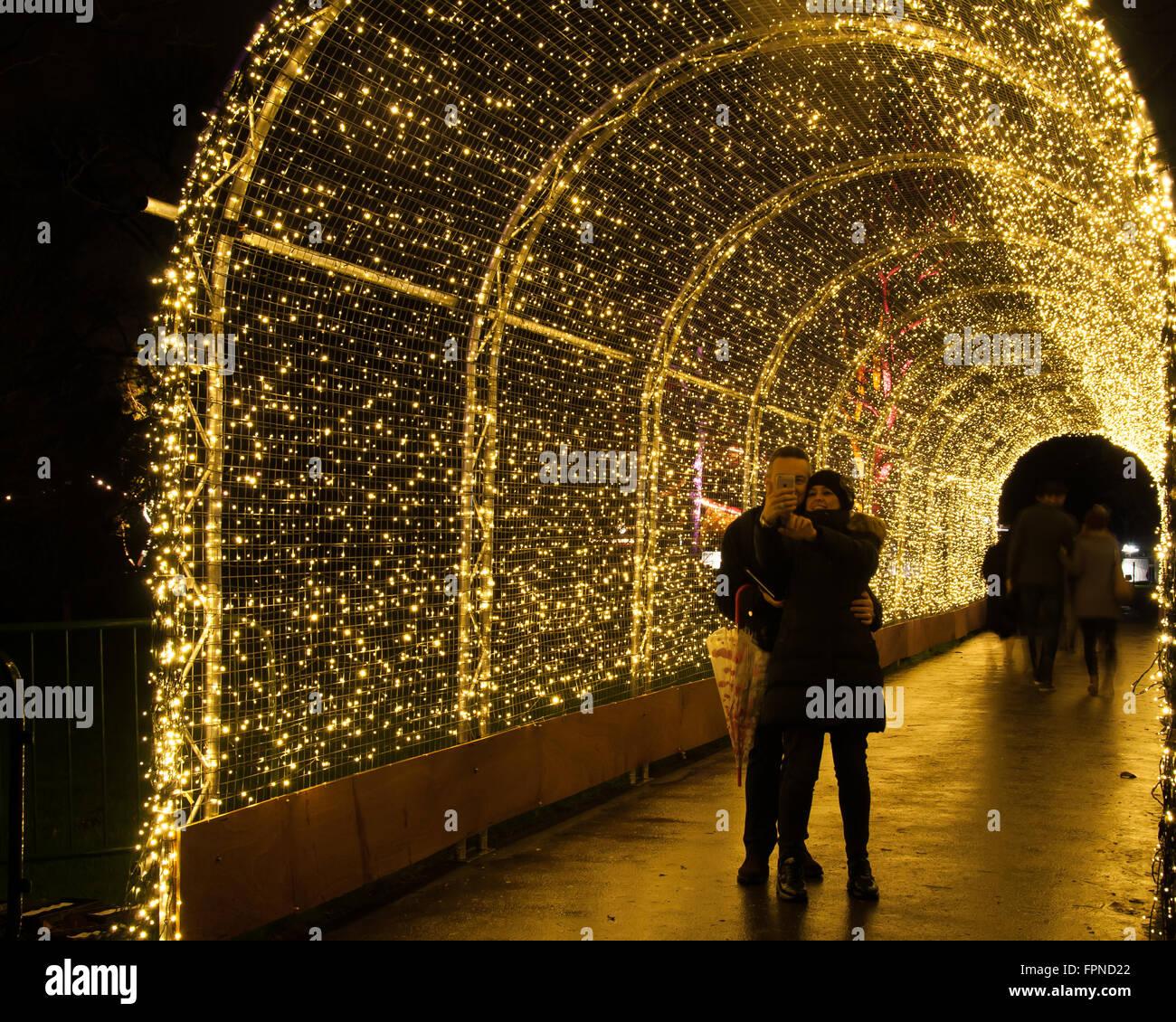 Couple In Love Taking Selfie In Tunnel Of Lights Seasonal
