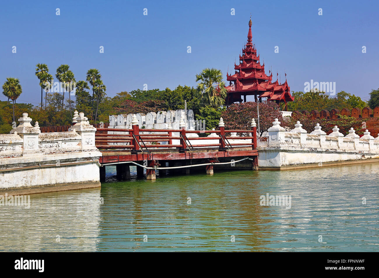 Gate and bridge over the moat of the Mandalay Palace, Mandalay, Myanmar (Burma) - Stock Image