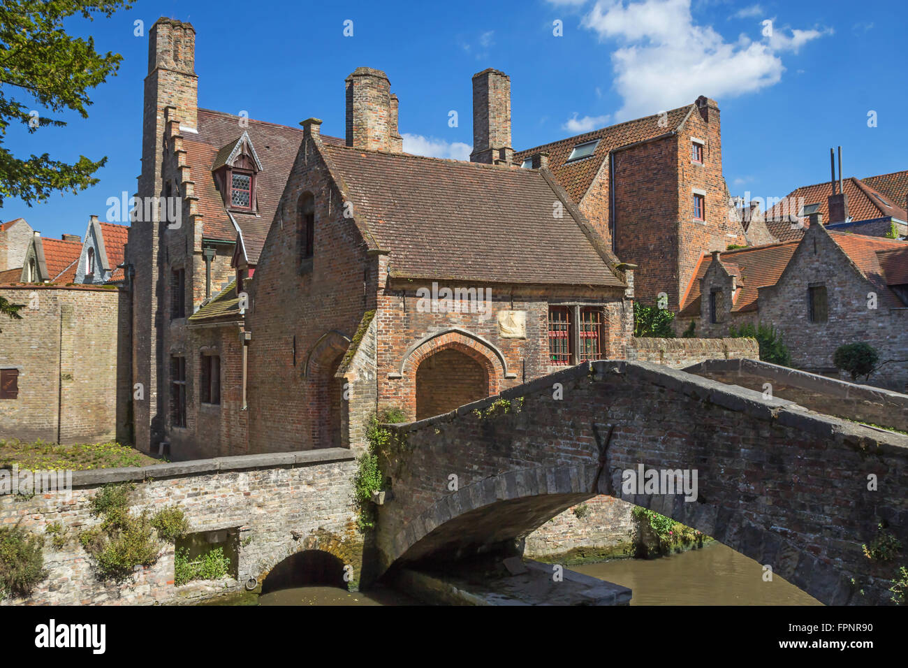 The famous 900 year old stone bridge in Bruges (Belgium) - Stock Image